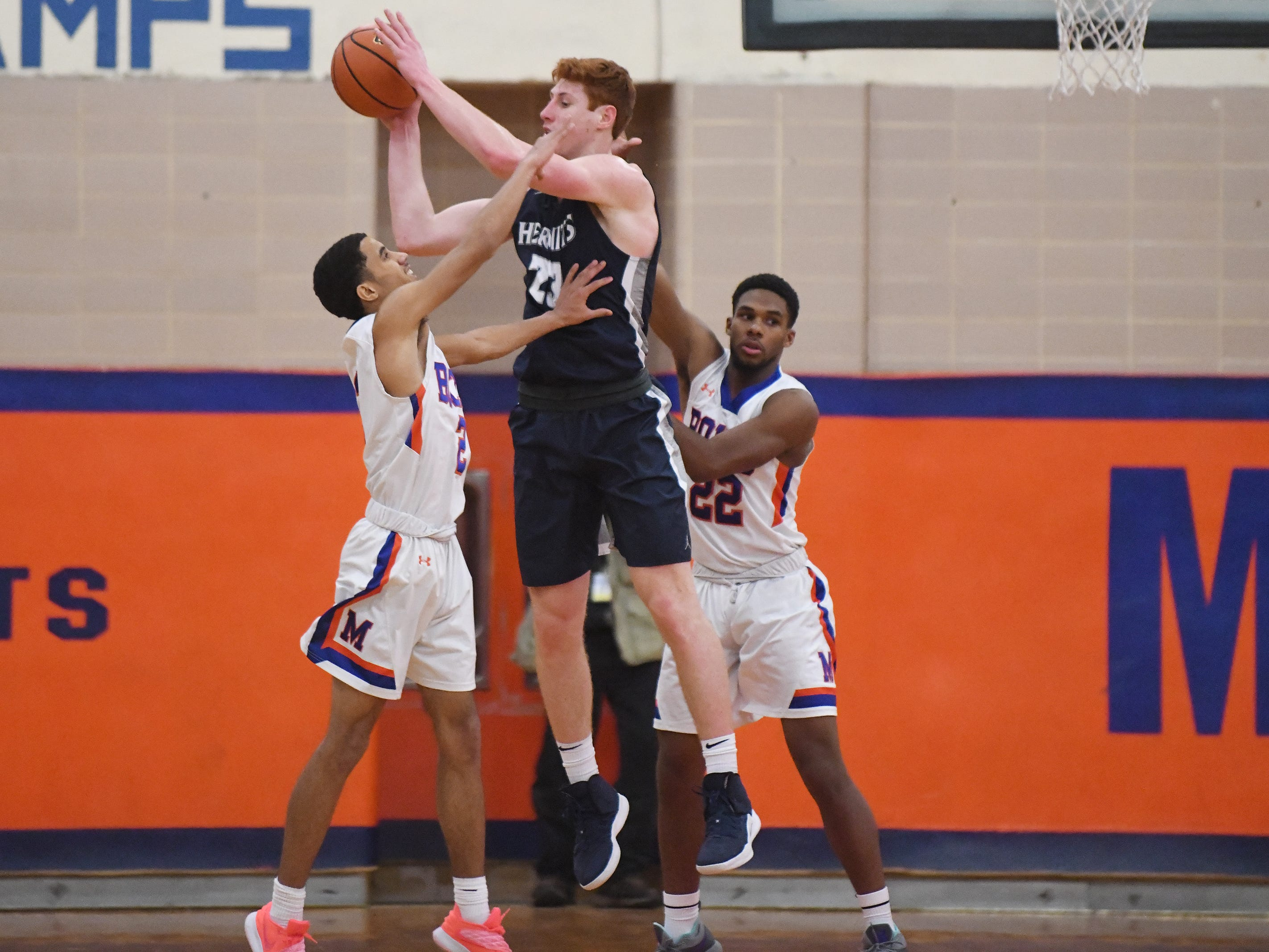 St. Augustine's Andrew Delaney grabs a pass during a game against Millville. The Hermits topped the Thunderbolts 66-53 on Friday, Jan. 18, 2019.