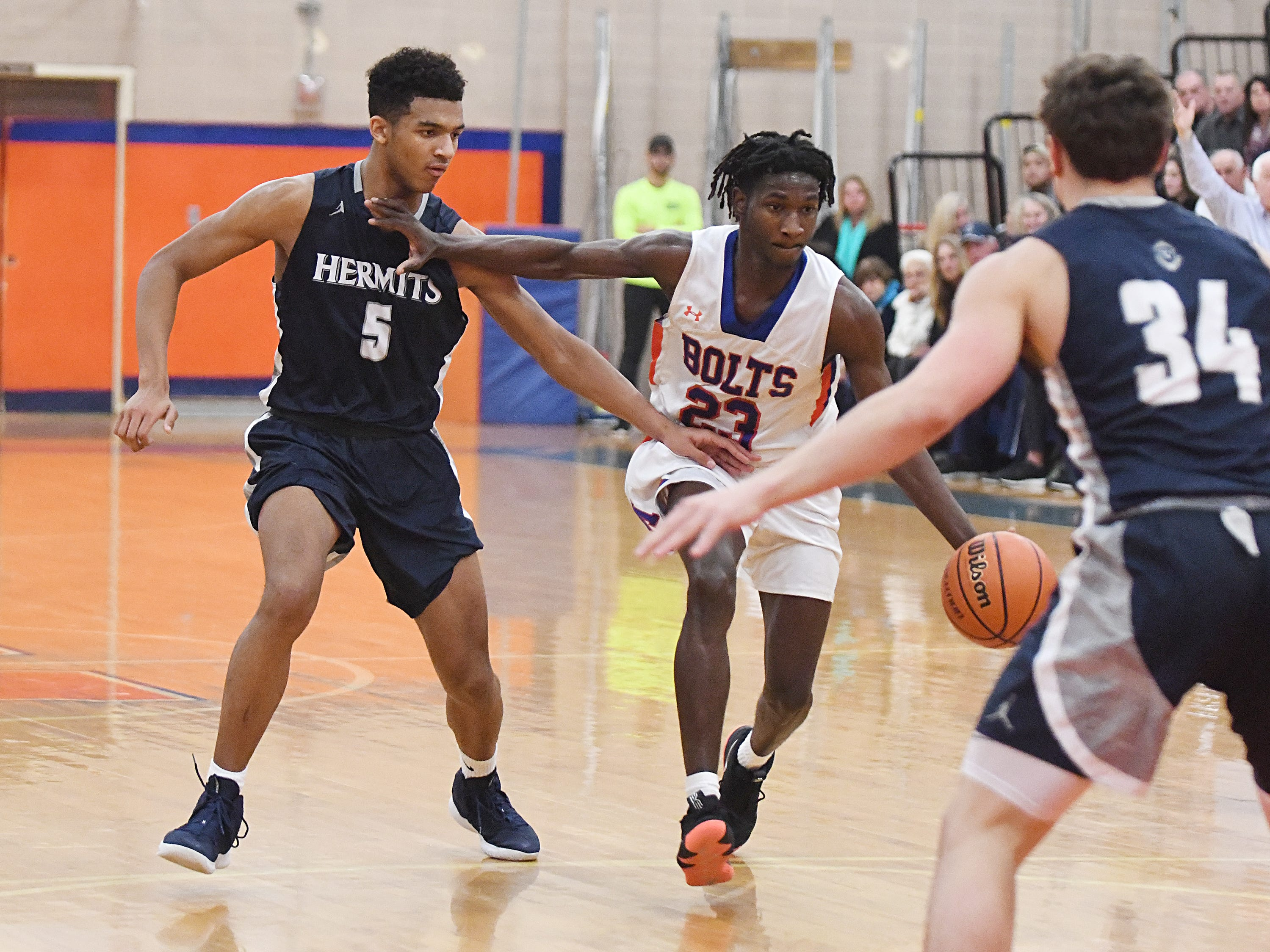 Millville's Rynell Lawrence drives the ball away from St. Augustine's Charles Solomon. The Hermits topped the Thunderbolts 66-53 on Friday, Jan. 18, 2019.