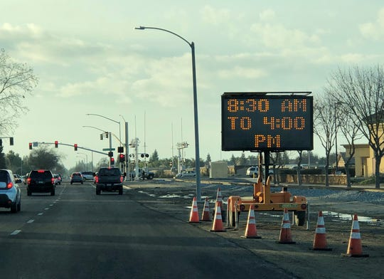 A sign on Goshen Avenue near Demaree Street alerts drivers of road closures and delays on Friday, January 18, 2019.