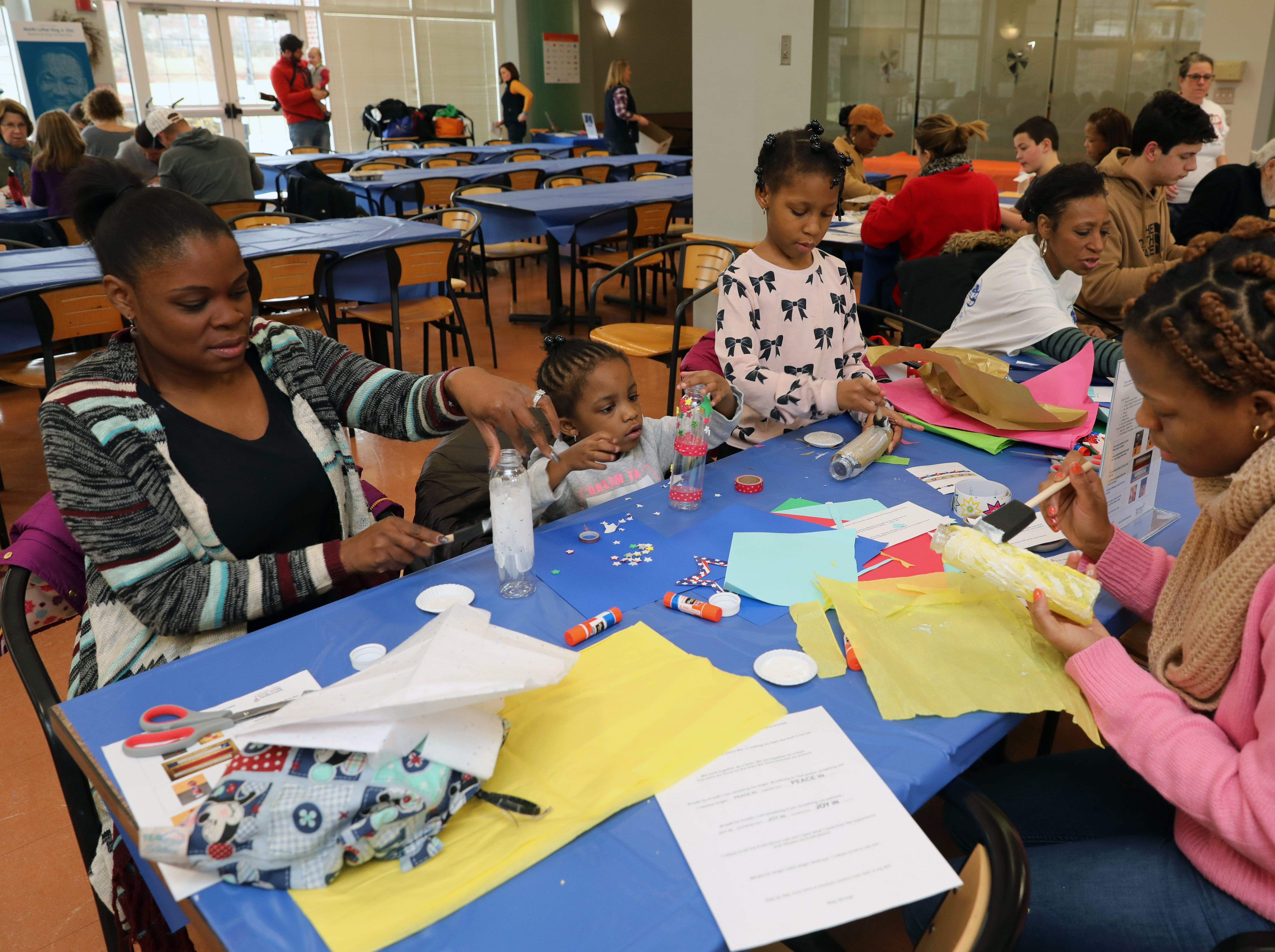 """From left: Sherell Ferrer, Savanna Ferrer, 4, Faith Ferrer, 8 and Tatyana Ferrer create gratitude jars to benefit """"United for the Troops"""" during the Volunteer New York, Martin Luther King Jr. National Day of Service program at Dominican College in Orangeburg, Jan. 19, 2019."""