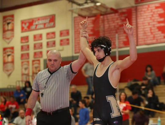 Nanuet's Chris DiModugno defeats North Rockland's Sean Garofal in the 120-pound match in the Rockland County Wrestling Championships at Tappan Zee High School in Orangburg on Saturday, January 19, 2019.