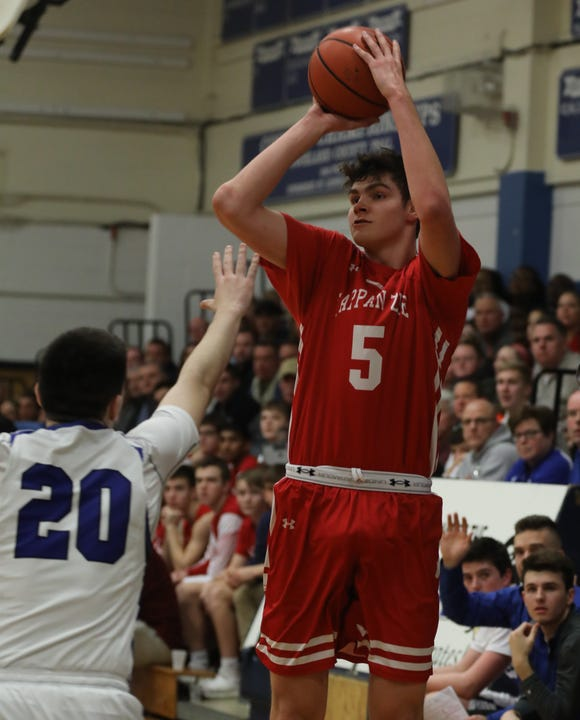 Pearl River's Tim Clancy (20) guards Tappan Zee's  Aidan Cunney (5) as he sinks a three point shot during boys basketball game at Pearl River High School Jan. 18, 2019. Tappan Zee defeats Pearl River 52-37.