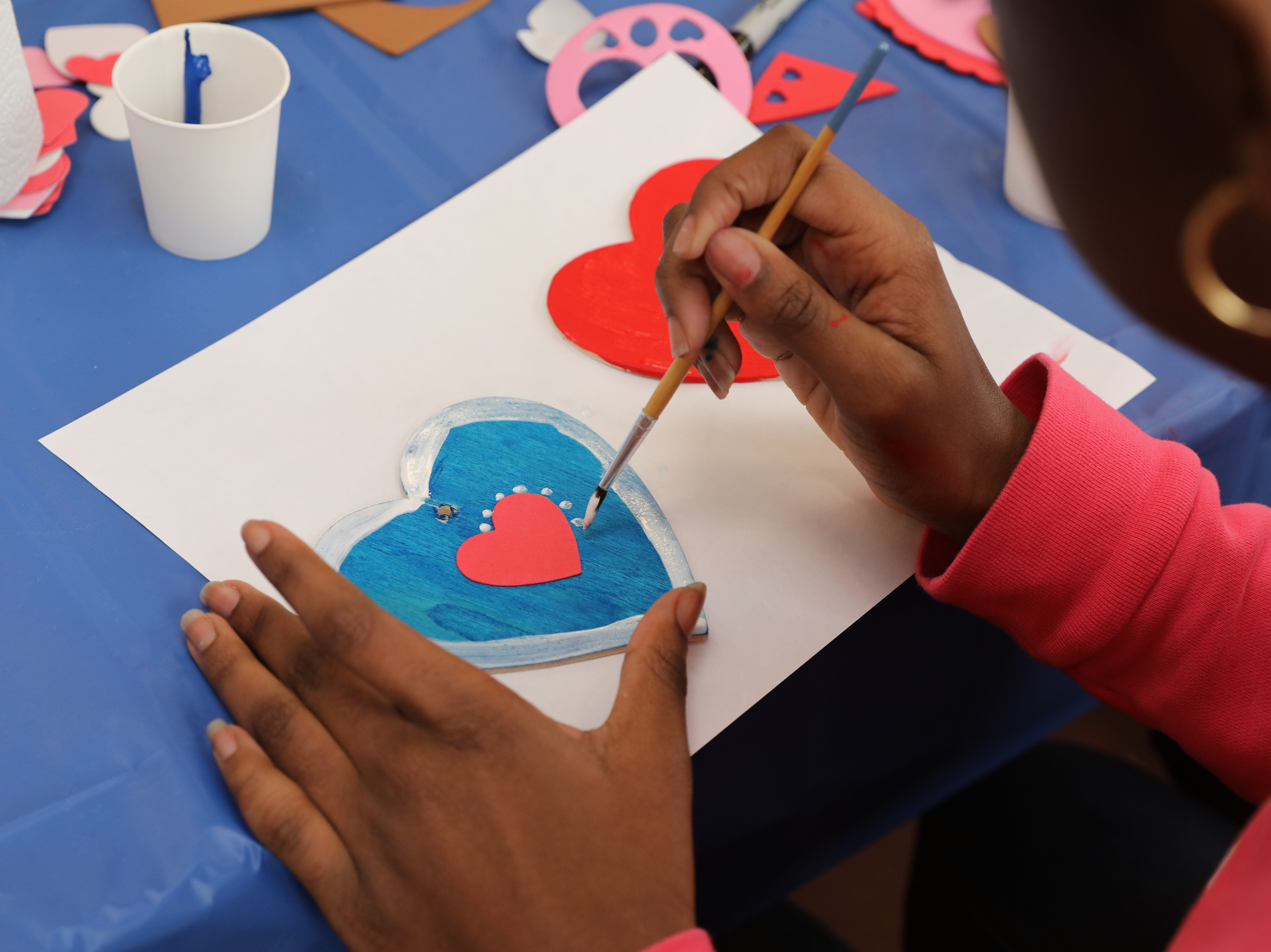 Bethany Webb, 12, from Valley Cottage, creates a Valentine's ornament during the Volunteer New York, Martin Luther King Jr. National Day of Service program at Dominican College in Orangeburg, Jan. 19, 2019.