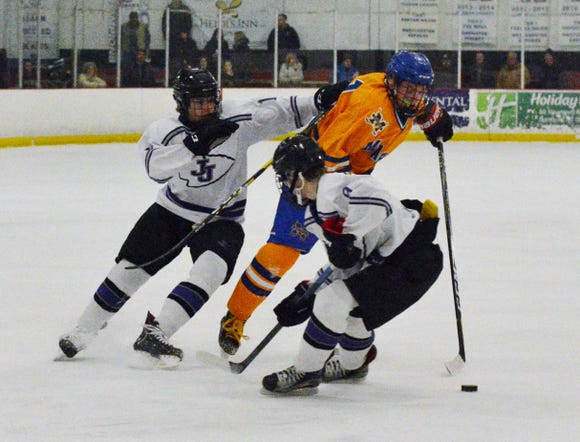 Mahopac forward T.J. McKee attempts to work through a pair of John Jay defenders on Friday, Jan. 18. 2019 at Brewster Ice Arena. Mahopac won the League B contest, 4-2.