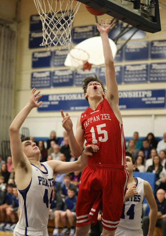 Pearl River's Michael Morrissey (44) guards Tappan Zee's Charlie Garrison (15) as he goes up for two during boys basketball game at Pearl River High School Jan. 18, 2019. Tappan Zee defeats Pearl River 52-37.