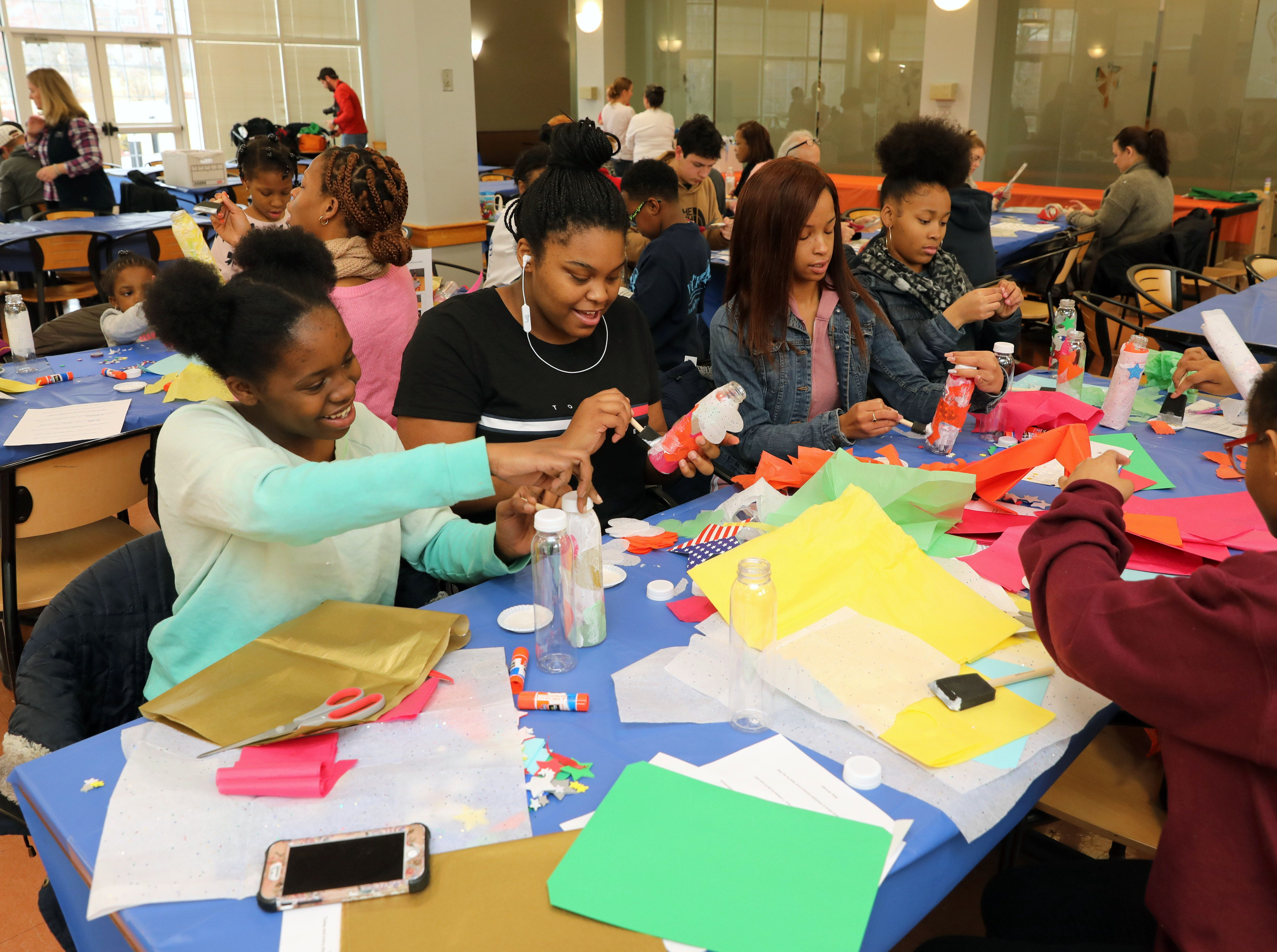 """Volunteers create gratitude jars to benefit """"United for the Troops"""" during the Volunteer New York, Martin Luther King Jr. National Day of Service program at Dominican College in Orangeburg, Jan. 19, 2019."""