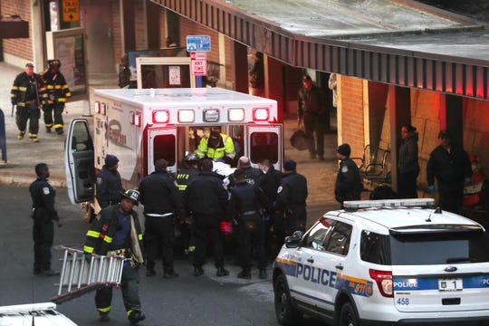 Rescue workers from White Plains carry a person that was struck by a train to an awaiting ambulance at the White Plains train station  Jan. 19, 2019. The injured person was transported to the Westchester Medical Center in Valhalla.