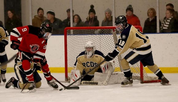 Declan Lavelle of Rye and Shane Holmes of Rye Country Day battle in front of the Rye Country Day goals during a varsity hockey game at Rye Country Day School Jan. 18, 2019. Rye Country Day defeated Rye 6-3.