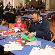 Madison Grau, 4 and Michael Bookman work on crafting greeting cards during the Volunteer New York, Martin Luther King Jr. National Day of Service program at Dominican College in Orangeburg, Jan. 19, 2019.