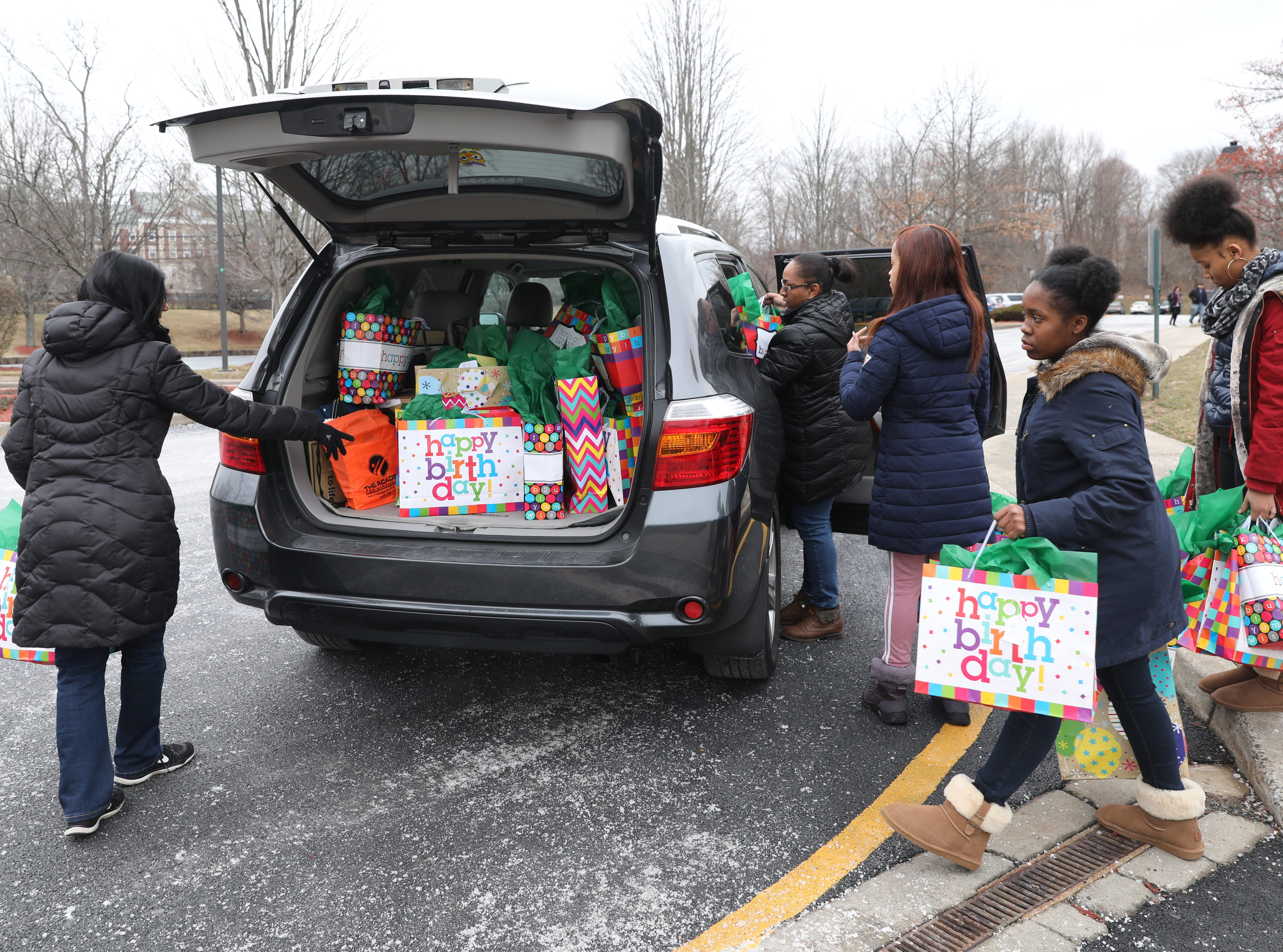 """""""Birthday Bags"""" are loaded into a car for transport, during the Volunteer New York, Martin Luther King Jr. National Day of Service program at Dominican College in Orangeburg, Jan. 19, 2019. The birthday bags will be brought to the Nyack Center for distribution."""