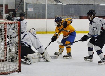 John Jay goalie Eric Sasimovich covers up a shot by Brian O'Shea.