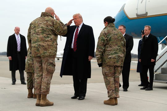 President Donald Trump greets Chief Master Sgt. Anthony W. Green Command Chief Master Sergeant, 436th Airlift Wing at Dover Air Force Base, Del., Saturday, Jan. 19, 2019, as he arrives to pay tribute to the four Americans killed in a suicide bomb attack in Syria as their remains are returned as Chief Master Sgt. Danielle M. Hirvela, Chief Enlisted Manager, Air Force Mortuary Affairs Operations, third from right, and Secretary of State Mike Pompeo and acting Secretary of Defense Patrick Shanahan, right, watch. (AP Photo/Andrew Harnik)