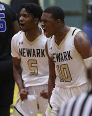 Newark's Anthony Earl (left) and Joey Hodges react after Hodges scored while being fouled in the Yellowjackets' 58-44 win against St. Georges at home Saturday.