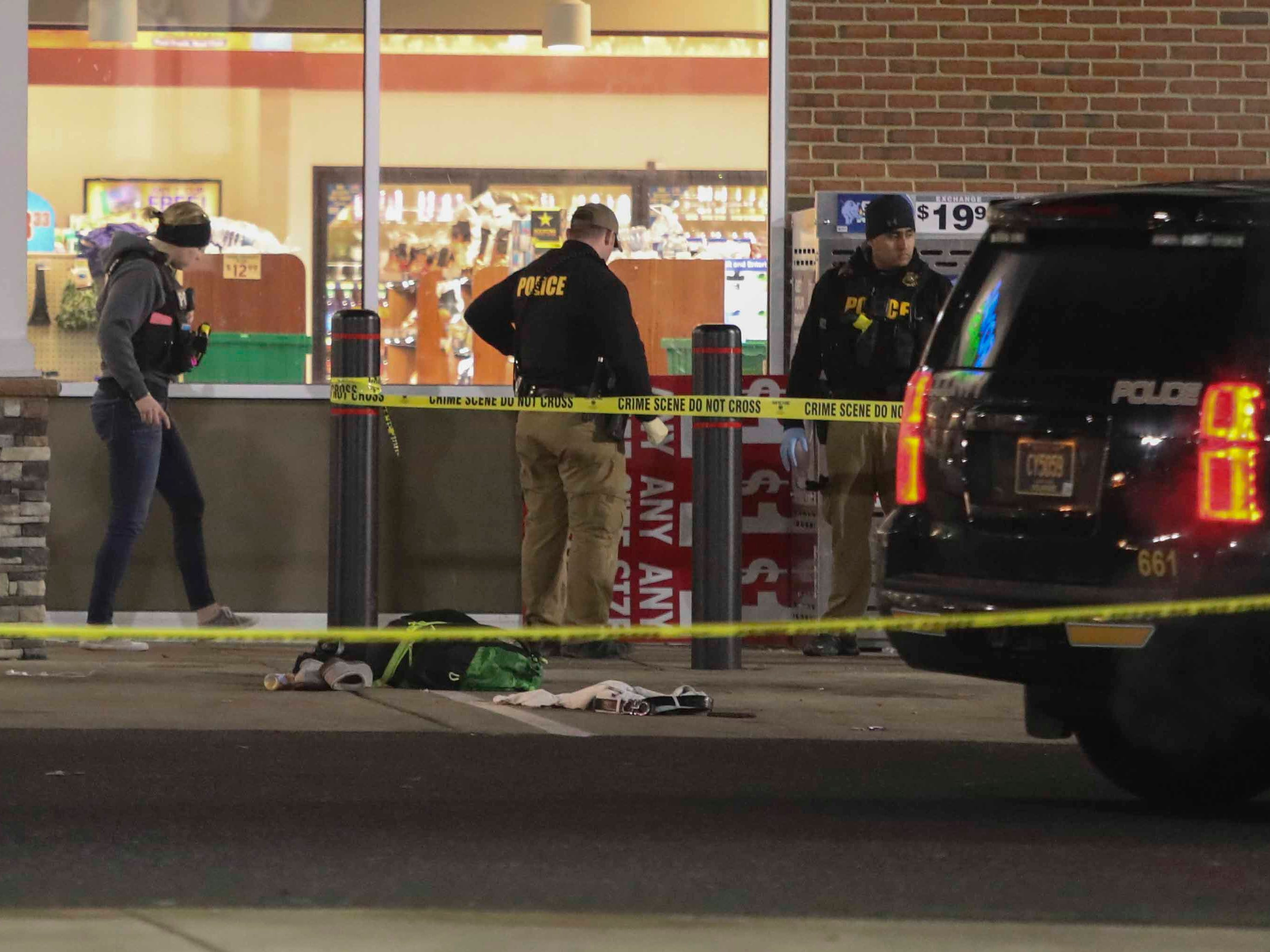 New Castle County Police investigate after a report of a shooting at the Royal Farms store on U.S. 40 in Bear Friday shortly before 10:30 p.m.