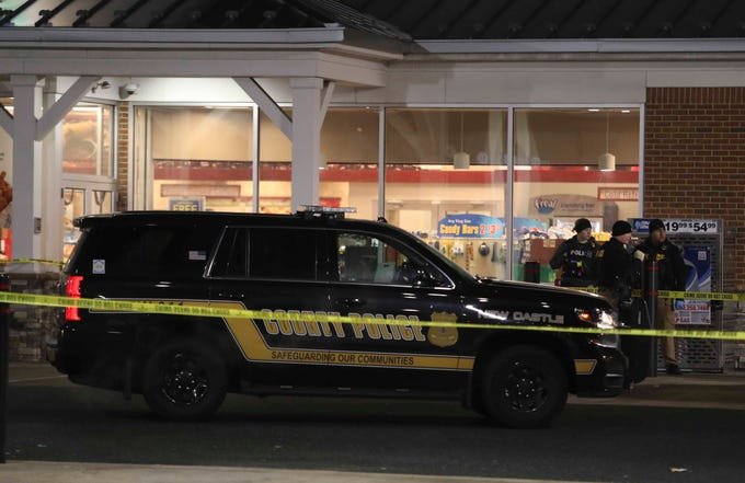New Castle County Police investigate after a report of a shooting near the Royal Farms store on U.S. 40 in Bear Friday shortly before 10:30 p.m.