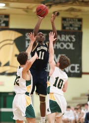 Darnell Vaughan shoots in the second half of the Sals' 54-36 win at St. Mark's High School Friday.