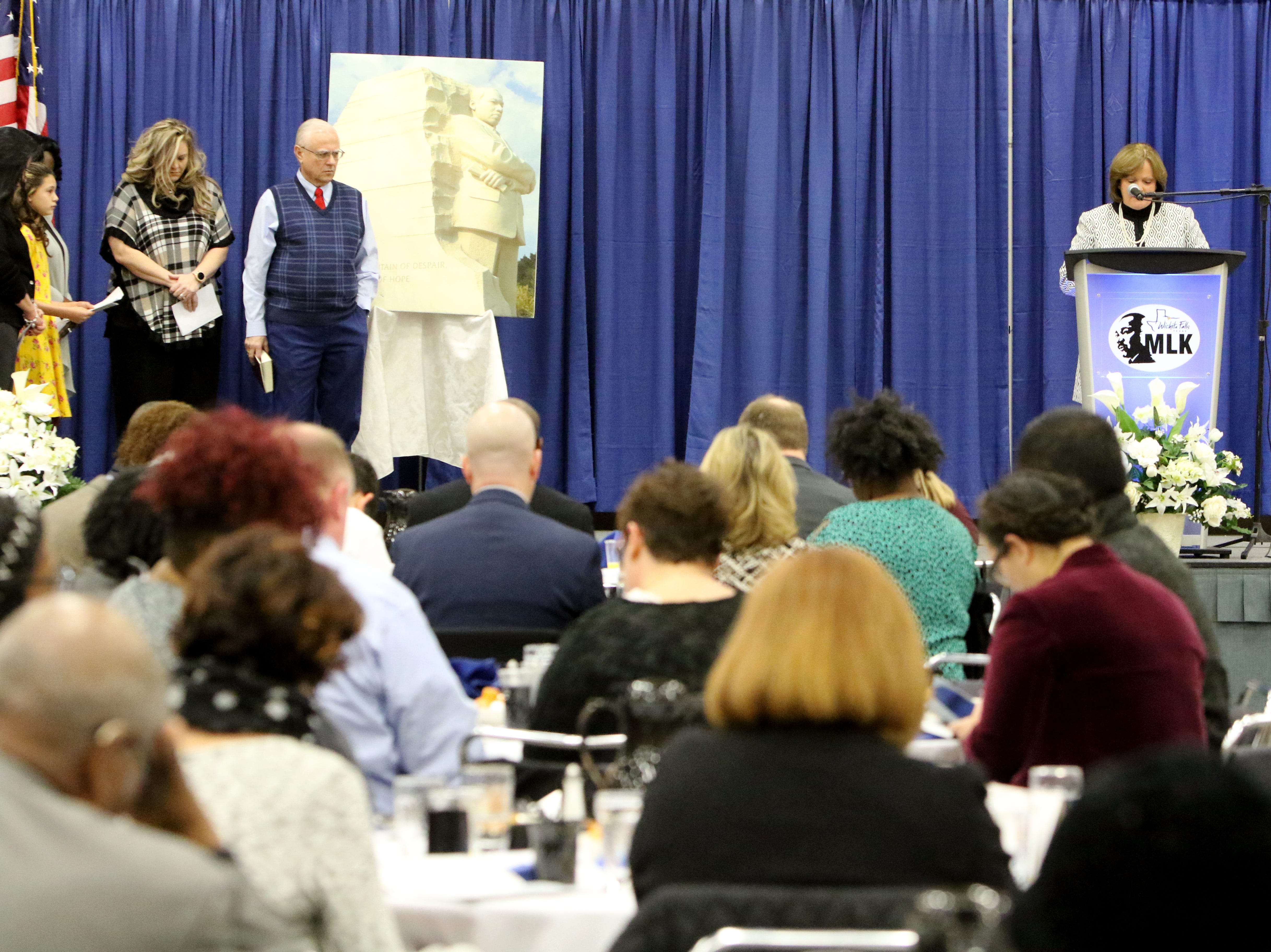 Leslie Schaffner gives the prayer for faith at the Dr. Martin Luther King, Jr. Scholarship and Prayer Breakfast Saturday, Jan. 19, 2019, at the Multi-Purpose Events Center.