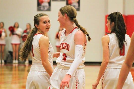 Captain Haley Couffer congratulates teammate Sarah Cowan after she scores.