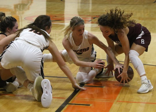 Nocona's Chloe Daughtry and Bowie's Brysen Richey go for the loose ball Friday, Jan. 18, 2019, in Nocona. The Lady Indians defeated the Lady Rabbits 52-44.