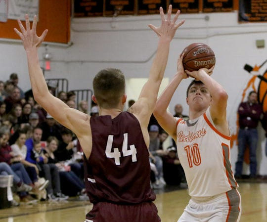 Nocona's Jason Sparkman shoots while guarded by Bowie's Jed Castles Friday, Jan. 18, 2019, in Nocona. The Jackrabbits defeated the Indians 62-44.