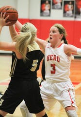 Holliday's Sarah Cowan defends against Henrietta's Caroline McDonnell. Cowan scored 8 points for the Eagles.