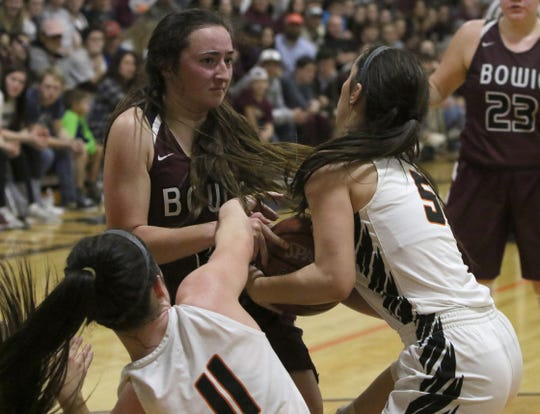 Bowie's Aslyn Davis, left, and Nocona's Taygon Jones fight for the ball Friday, Jan. 18, 2019, in Nocona. The Lady Indians defeated the Lady Rabbits 52-44.