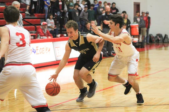 Henrietta's Mason Marchman dribbles down the court against Logan Swistak. Marchman scored two 3-pointers for the Bearcats.