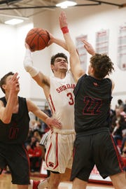 Sheridan's Ethan Heller gets fouled by Morgan's Gabe Altier.