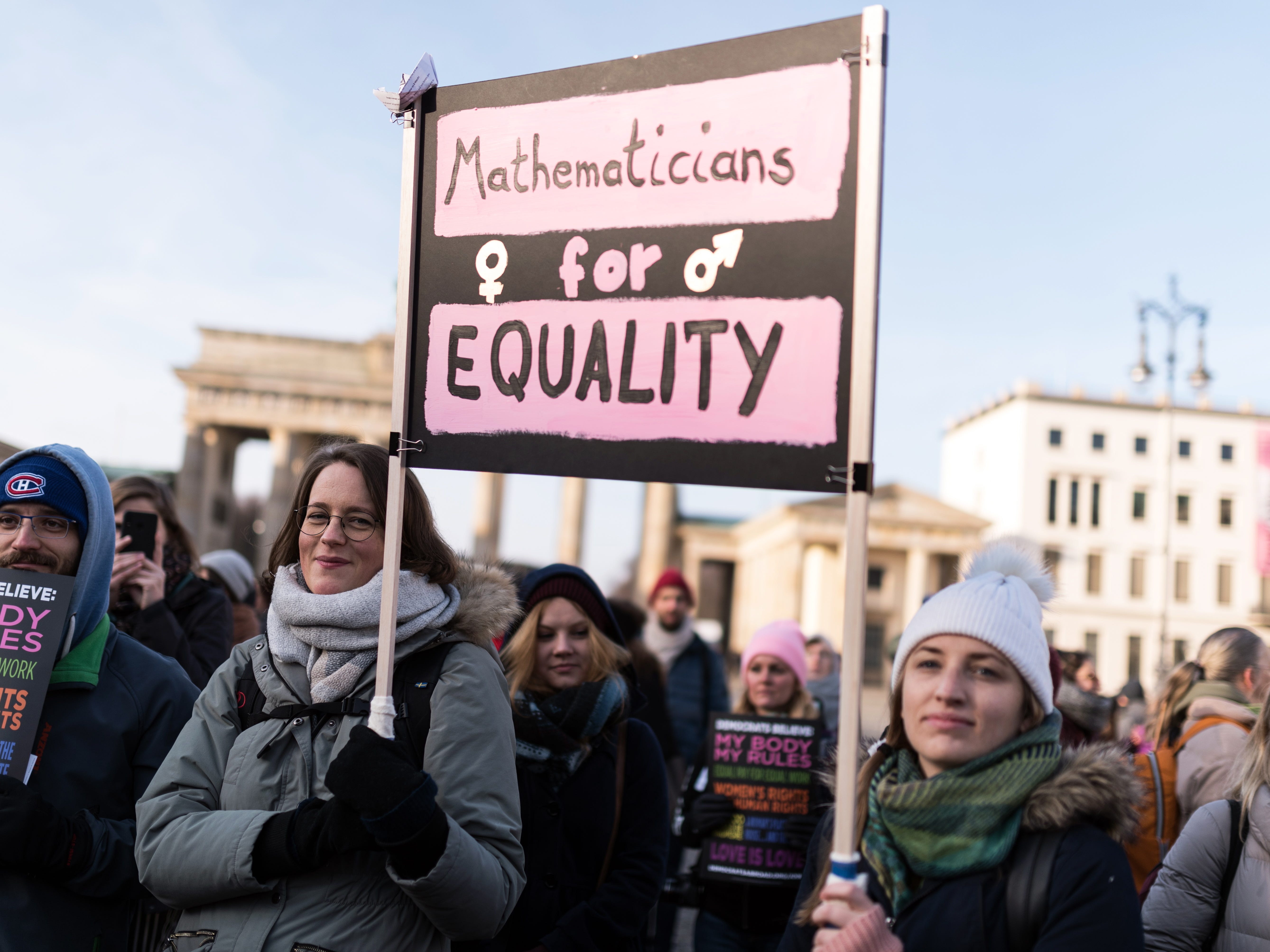 Two women hold a sign reading 'Mathematicians for equality' during the 2019 Wome's March in Berlin, Germany on Jan. 19, 2019. The march is to support women's rights, against racism and violence against women.