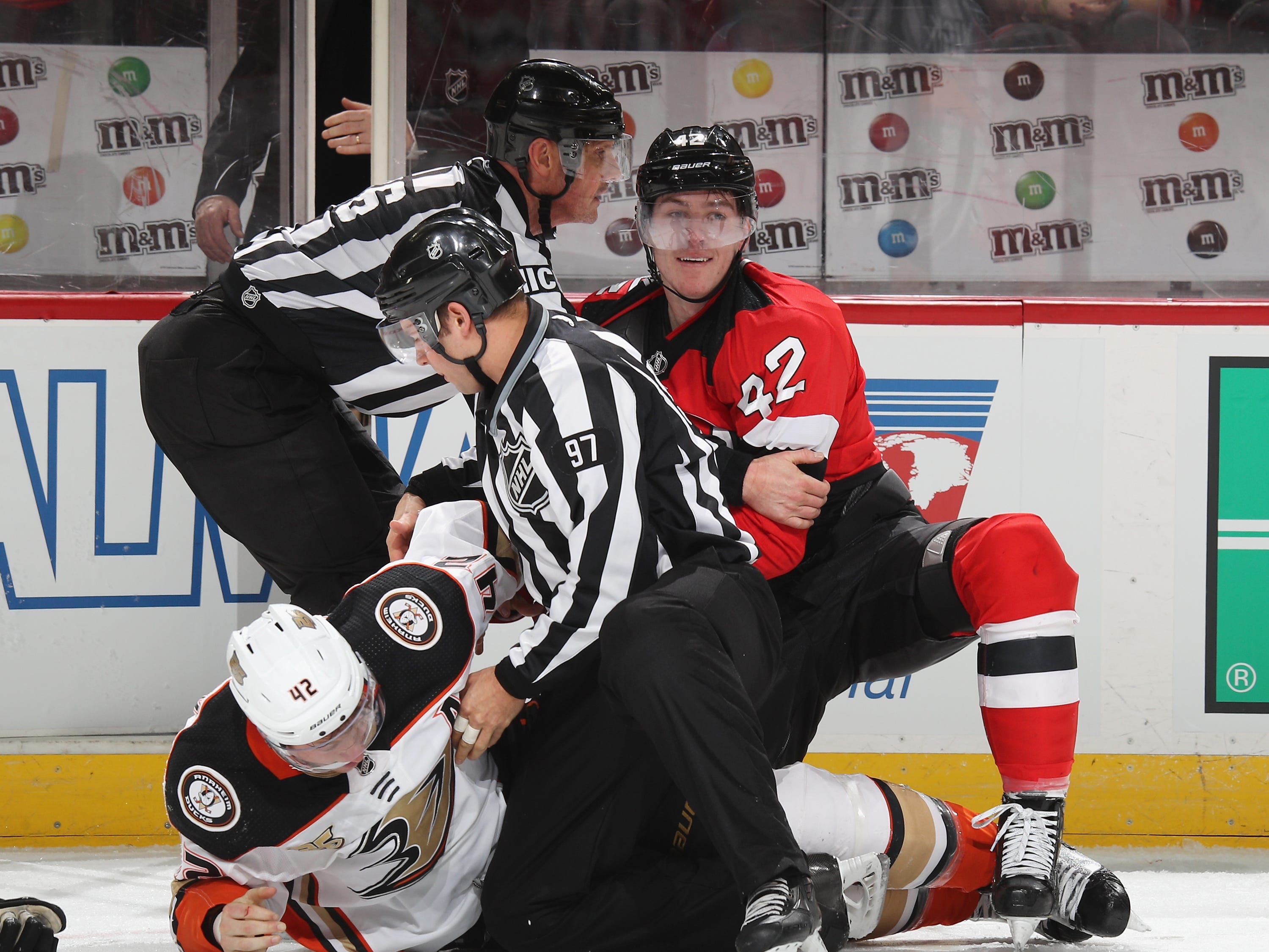 Jan. 19: New Jersey Devils' Nathan Bastian, right, vs. Anaheim Ducks' Josh Manson.