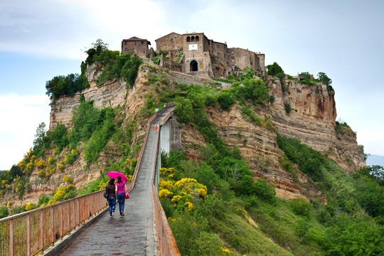 """A footpath is all that connects Italy's Civita di Bagnoregio to the """"mainland."""""""