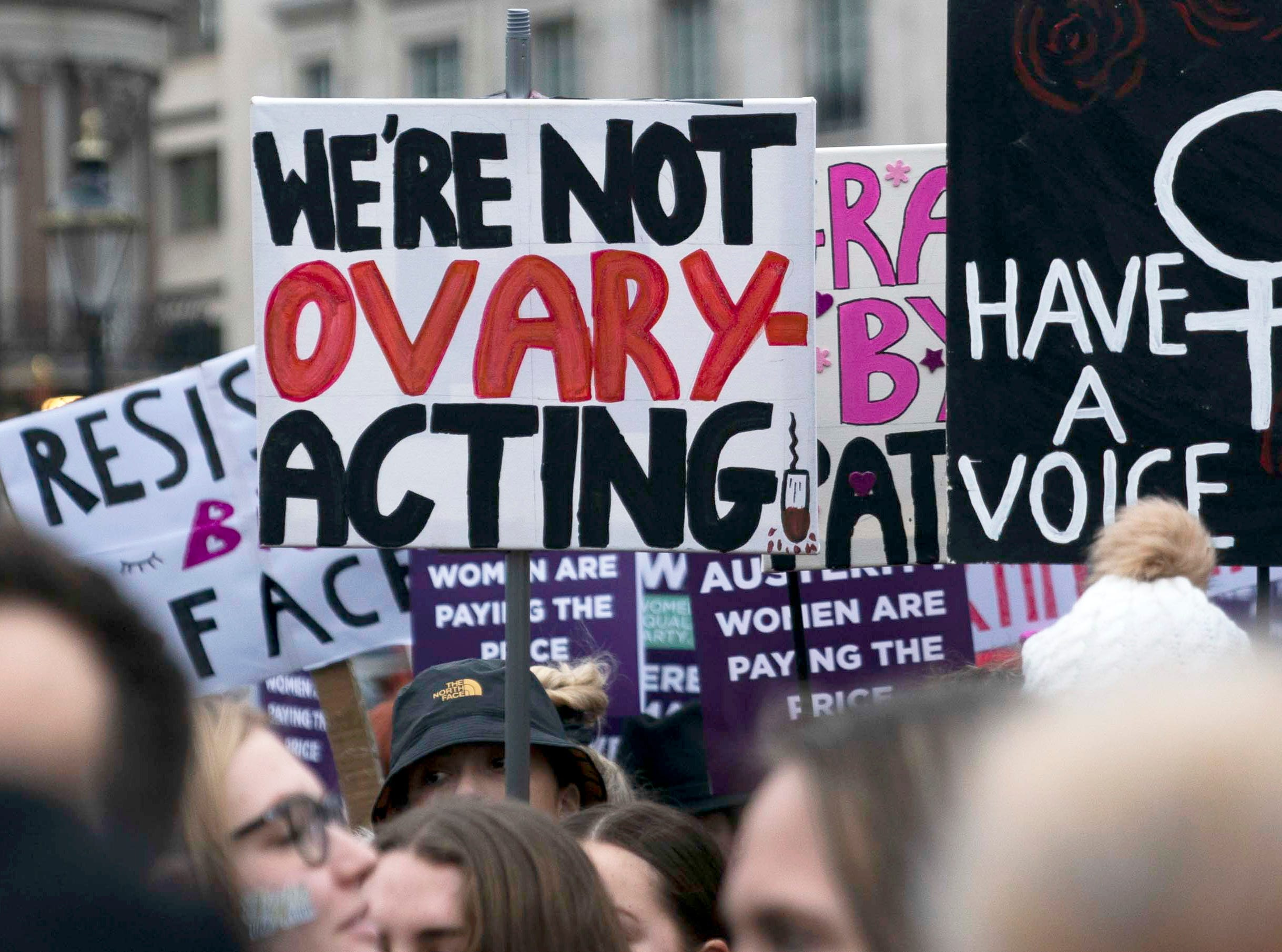 Protesters with placards 'We're not ovary-acting' and 'have a voice' take part in the 2019 Women's March in Central London, Britain on Jan. 19, 2019. Thousands of protesters called for greater protection and rights for women and end of austerity in Britain.