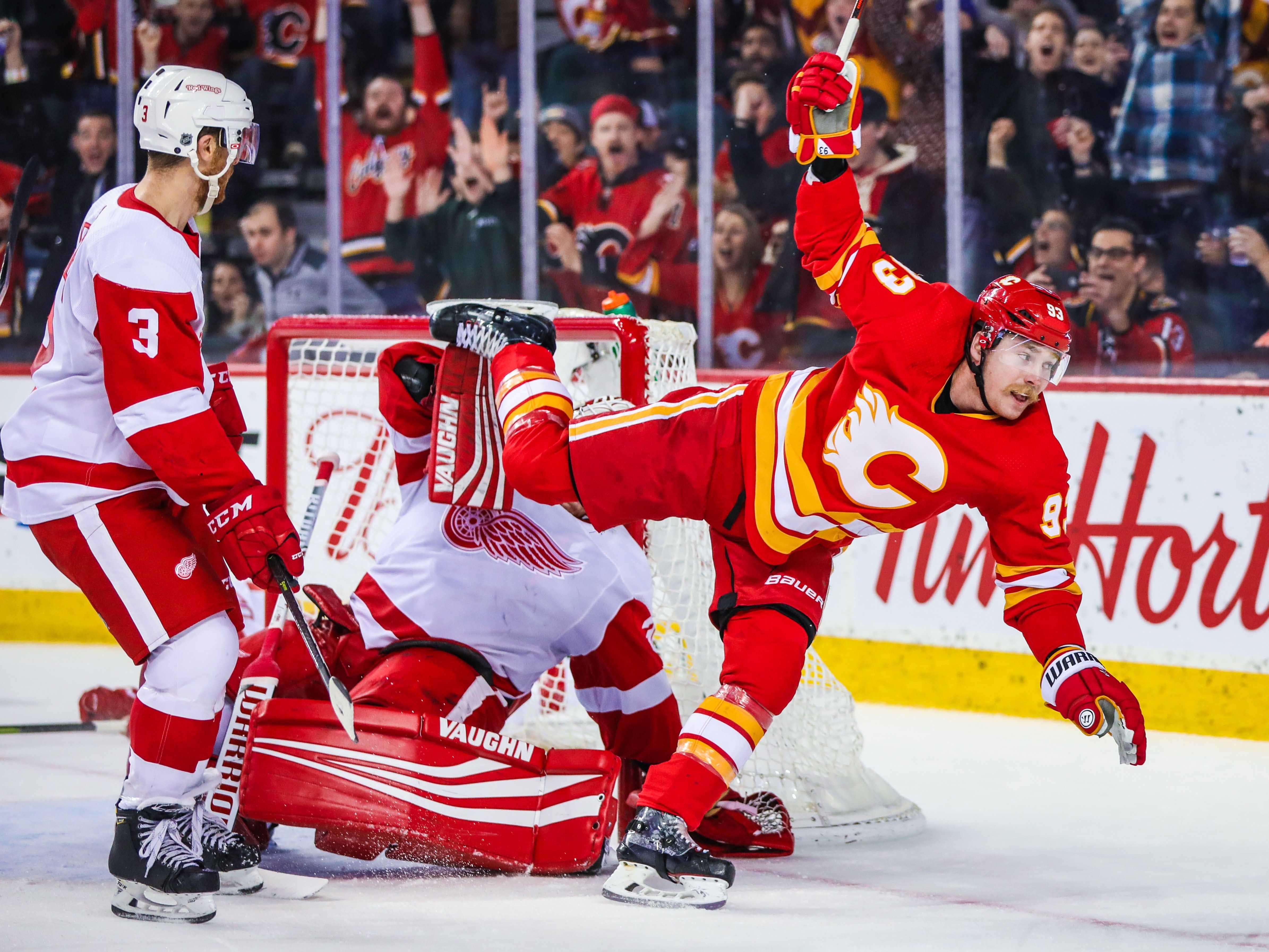 Jan. 18: Calgary Flames center Sam Bennett goes flying after scoring against Detroit Red Wings goalie Jimmy Howard.
