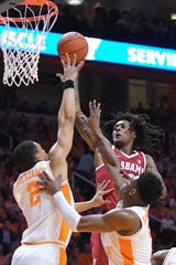 Alabama Crimson Tide guard John Petty (23) shoots the ball against Tennessee Volunteers forward Grant Williams (2) during the first half at Thompson-Boling Arena.