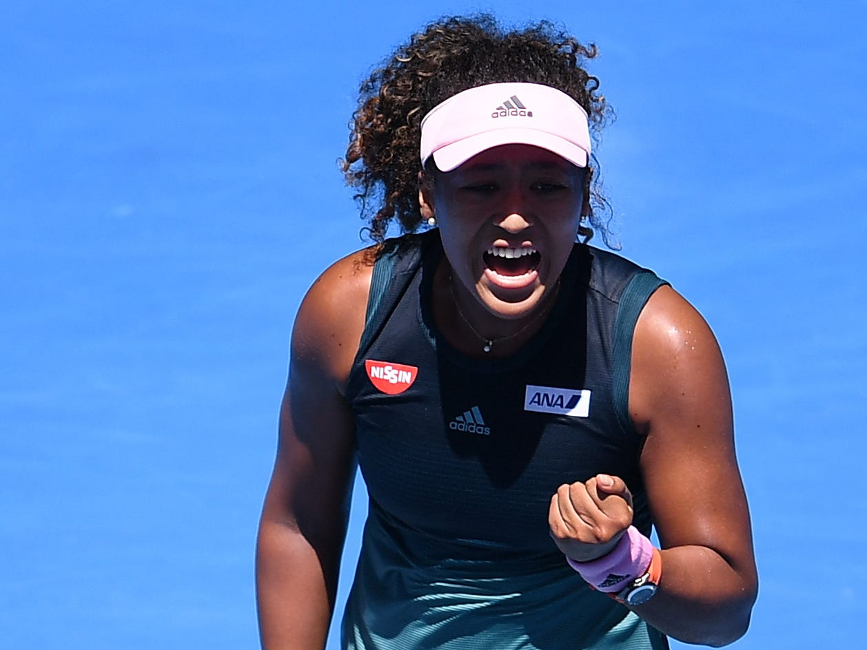 Naomi Osaka celebrates after defeating Su-Wei Hsieh during their third-round match.