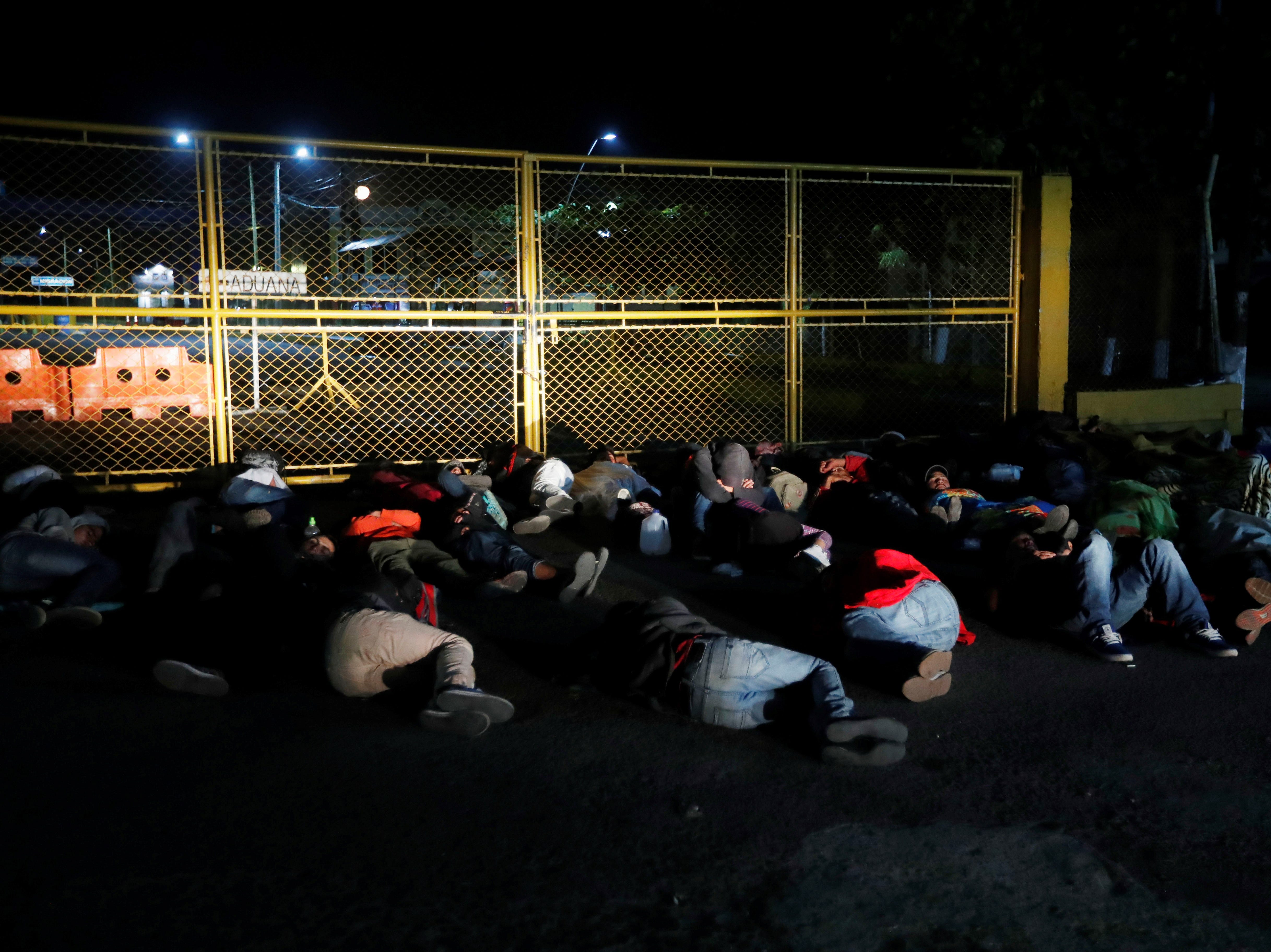 epa07301224 Central American migrants sleep at the entrance of the border office between Guatemala and Mexico in Tecun Uman, Guatemala, 19 January 2019. Hundreds of Central American migrants entered Mexico illegally and began their route to US on Saturday in the state of Chiapas, in southeastern Mexico, from Tapachula to Huixtla, at a distance of about 40 kilometers.  EPA-EFE/Esteban Biba ORG XMIT: AME9641