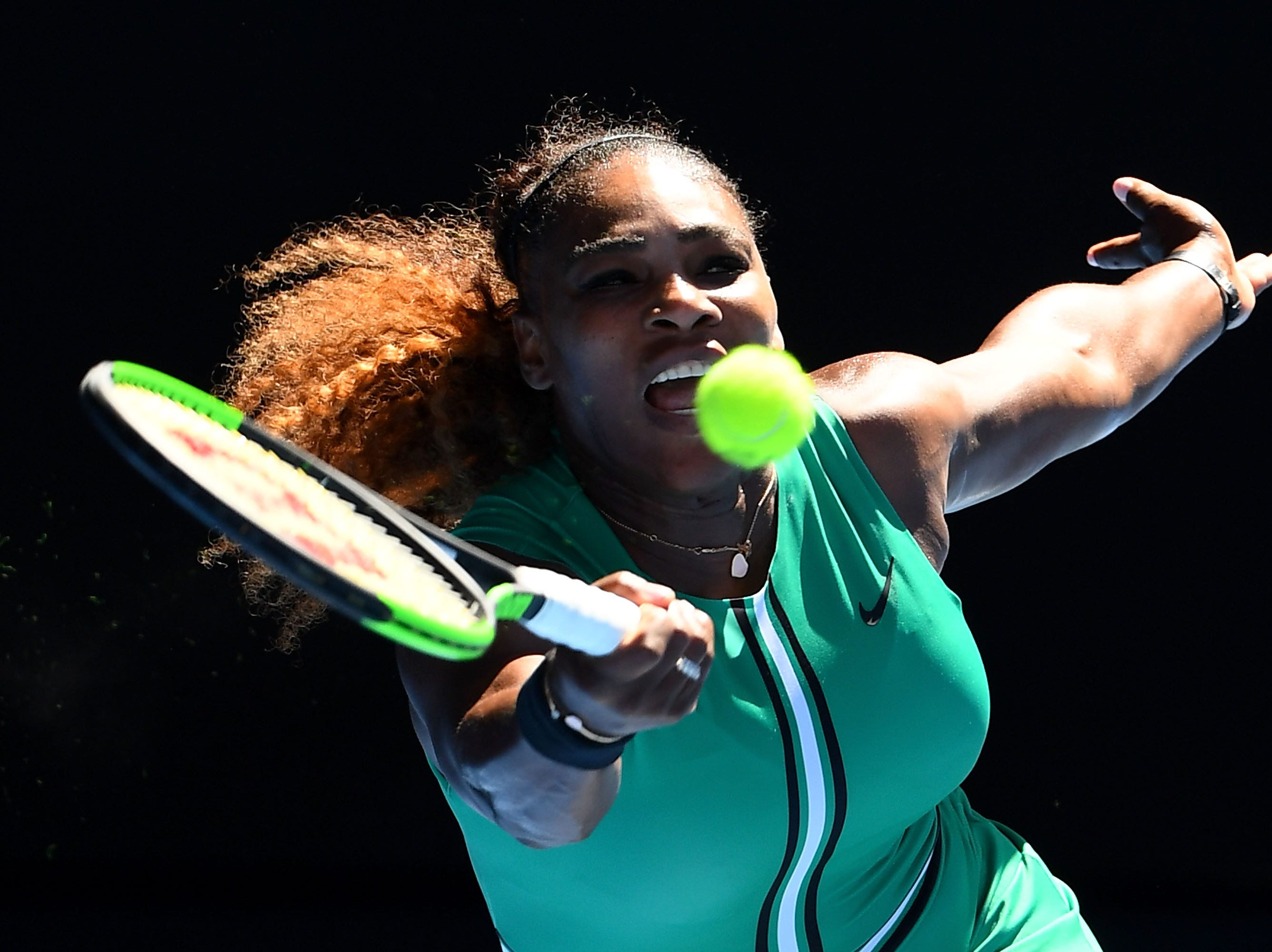 Serena Williams plays a forehand in her third round match against Dayana Yastremska.