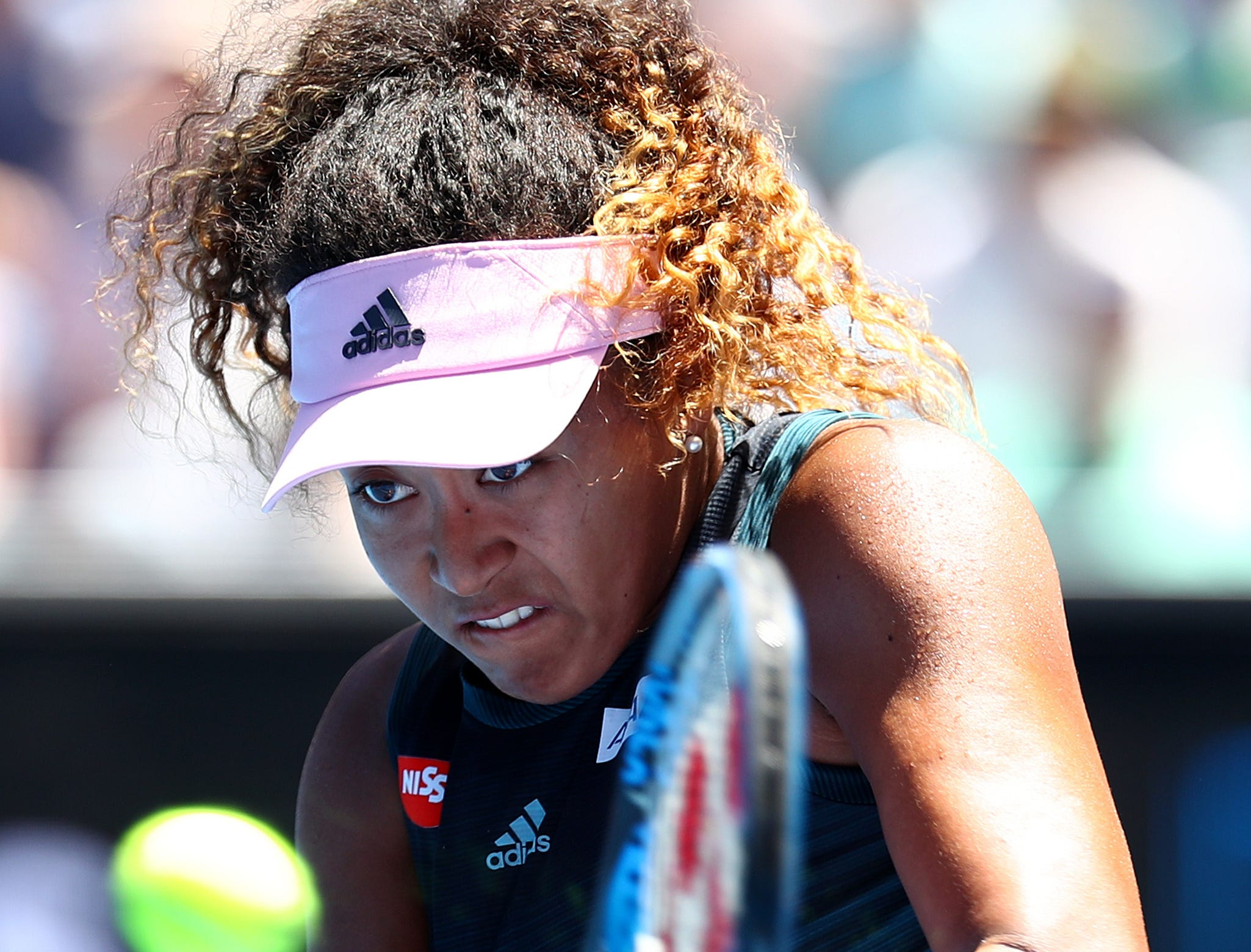Naomi Osaka of Japan plays a backhand in her third-round match against Su-Wei Hsieh.