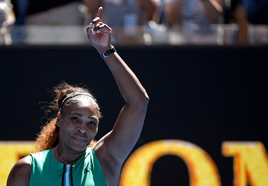 Serena Williams celebrates after defeating Ukraine's Dayana Yastremska during their third round match at the Australian Open in Melbourne, Australia, on  Jan. 19.