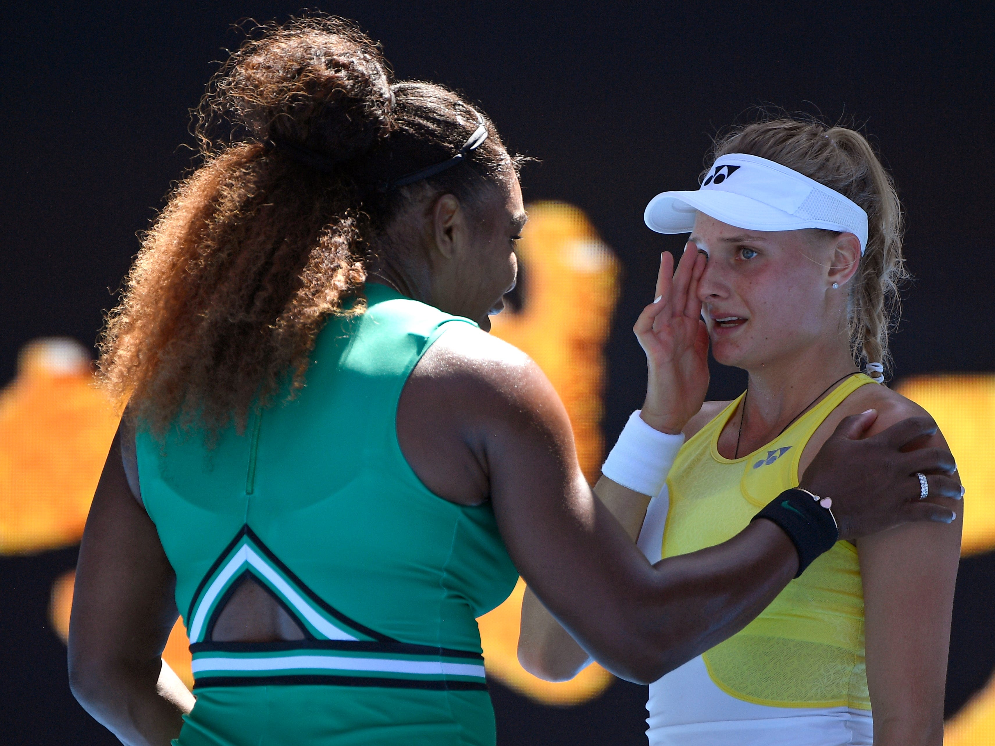 Serena Williams, left, consoles Dayana Yastremska after winning their third round match.