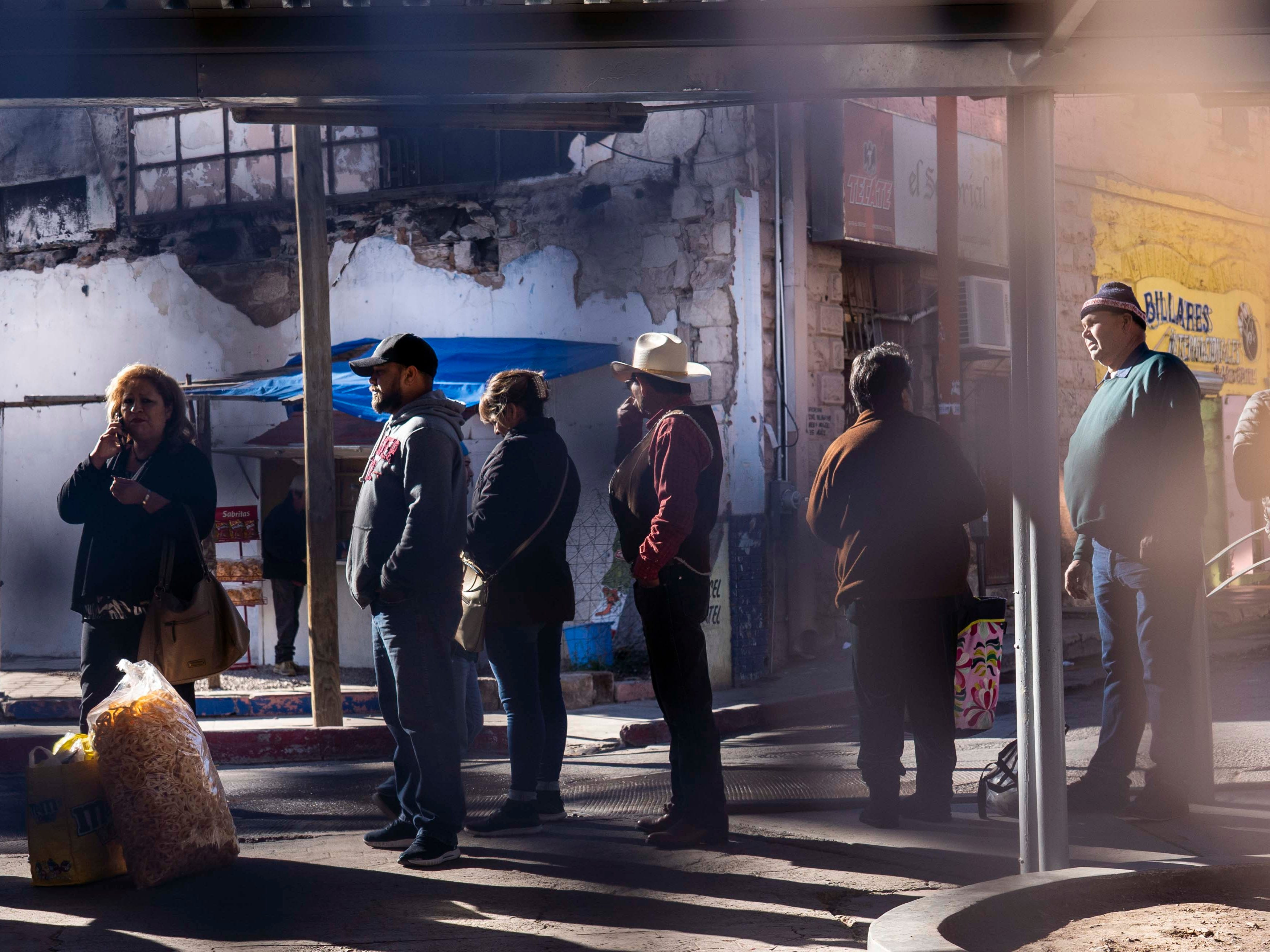 People wait in long lines to cross the border in Nogales, Arizona.