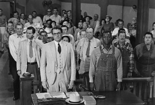 """Gregory Peck, front left, stars as Atticus Finch and Brock Peters, front right,  stars as Tom Robinson in the 1962 movie version of Harper Lee's Pulitzer Prize-winning novel """"To Kill a Mockingbird."""""""