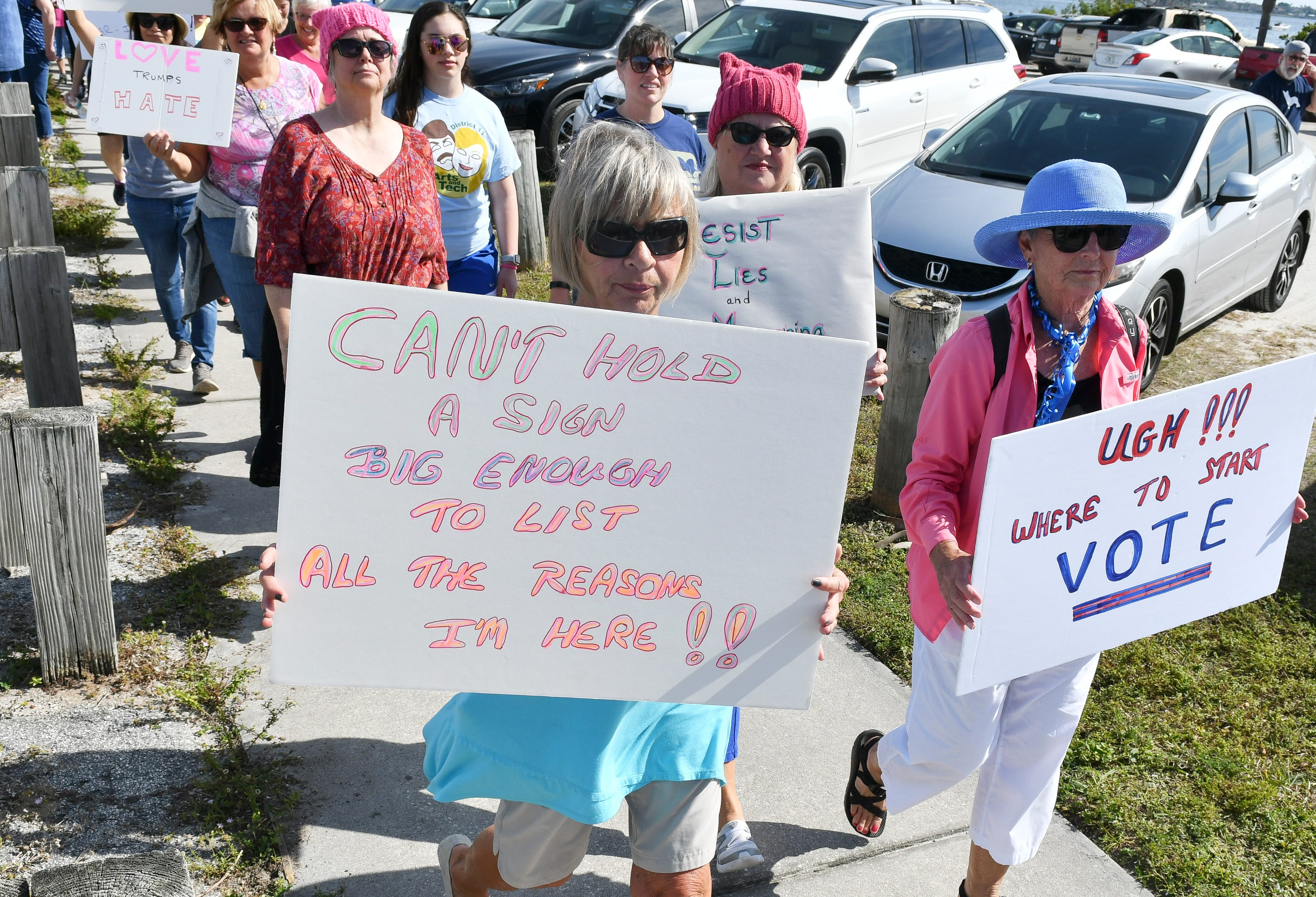 Hundreds of people walk the Eau Gallie Causeway in Melbourne, FL during a local observance of the national Women's March on Jan. 19, 2019.