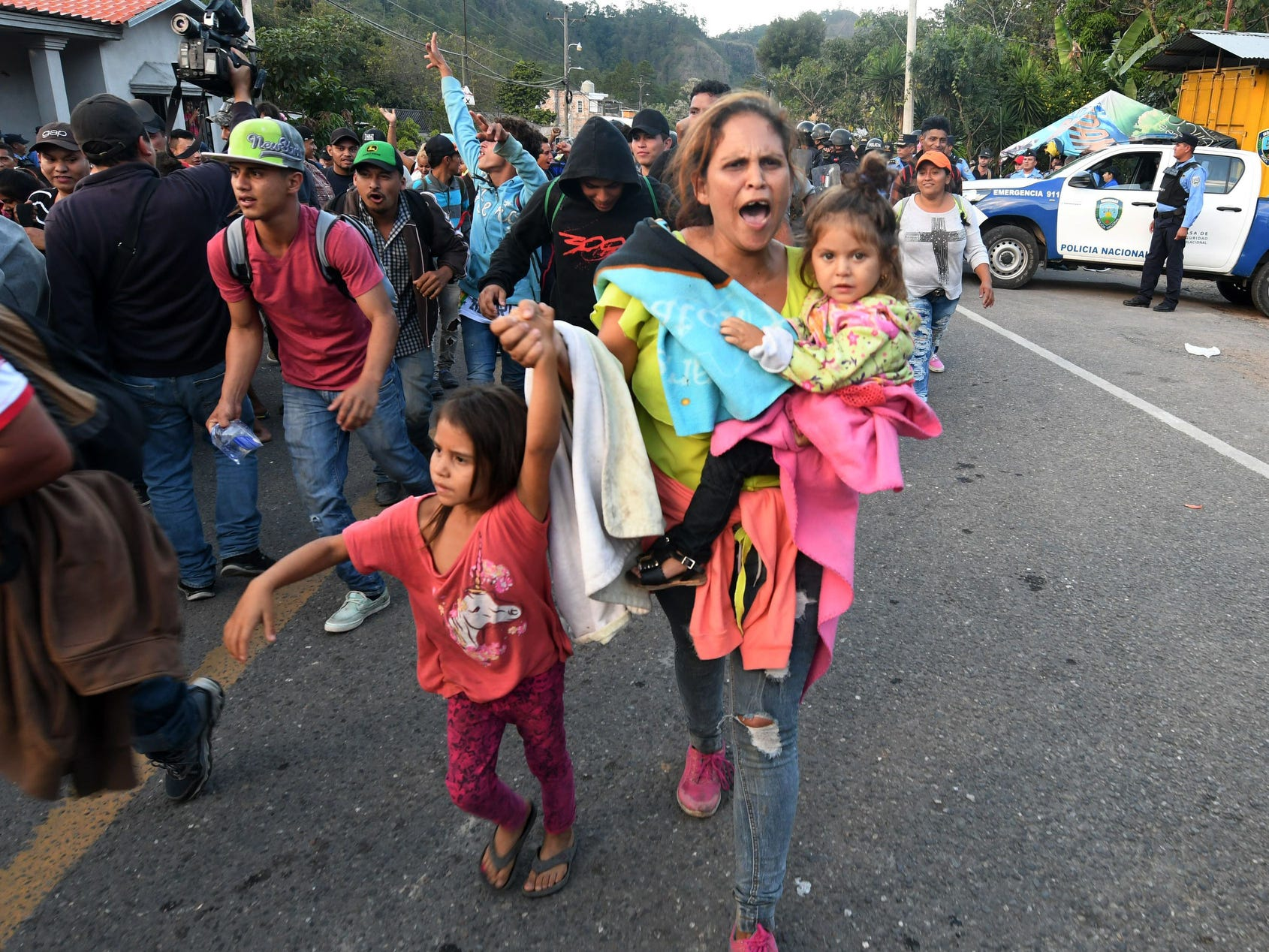 Honduran migrants heading to the United States with a second caravan walk after breaking through a police cordon in Agua Caliente, in the Honduras-Guatemala border on Jan. 15, 2019.