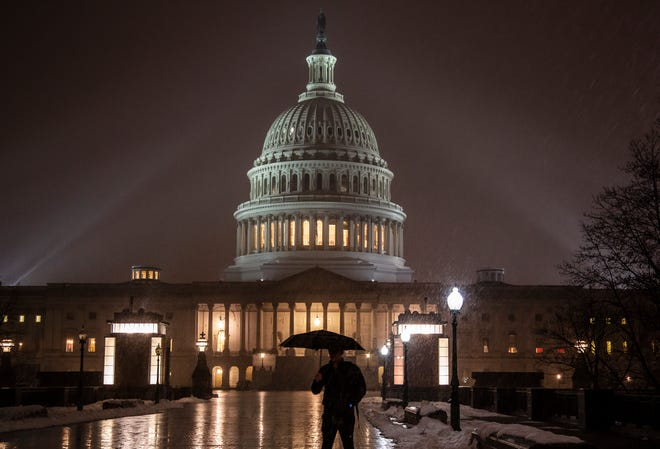 Snow falls on the Capitol as the partial government shutdown rolls to a fifth week.