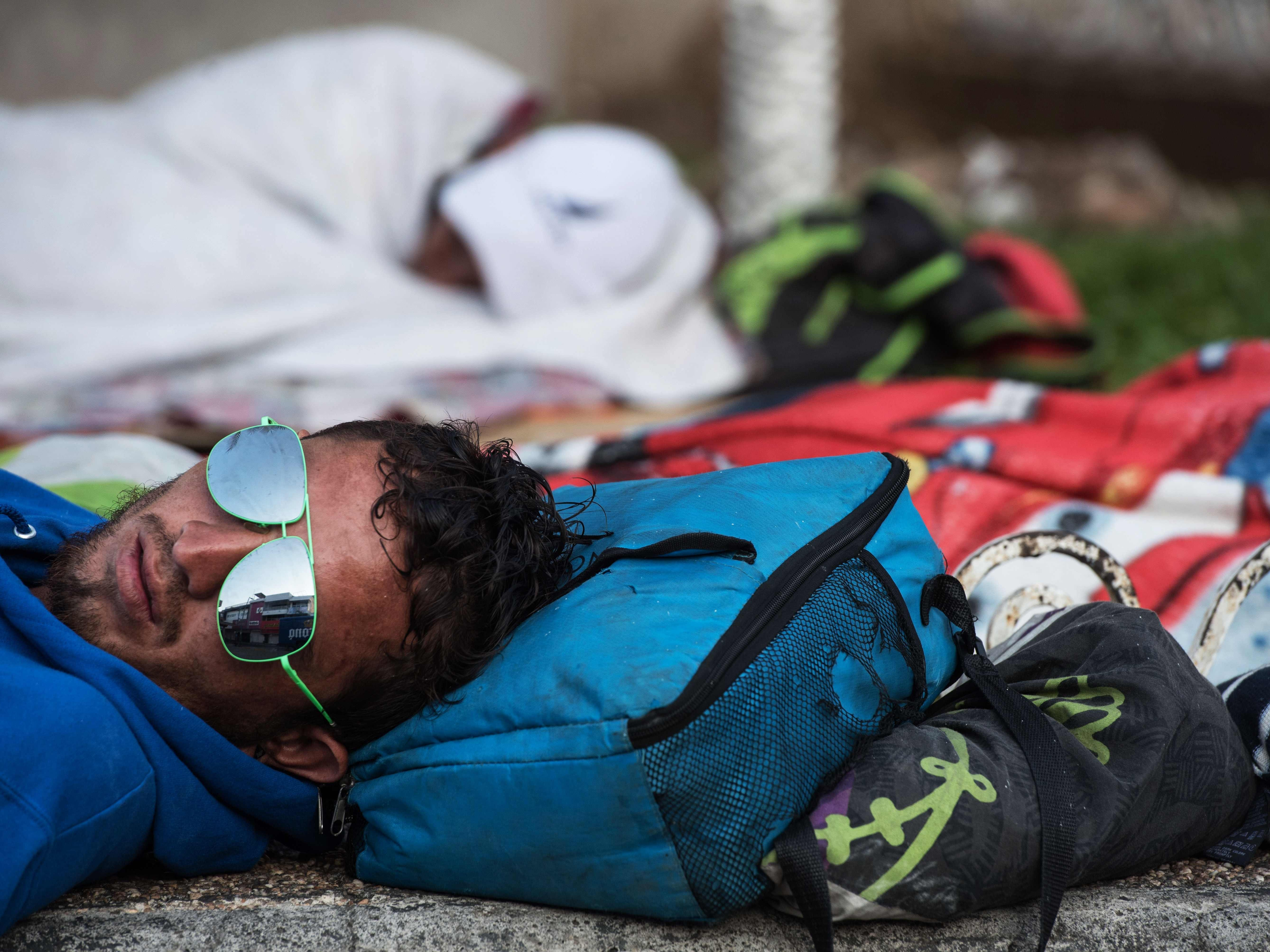 A Honduran migrant heading to the United States with a second caravan, rests during a stop in the journey in Tapachula, Chiapas state, southern Mexico on Jan. 19, 2019.  Hundreds of Central Americans entered Mexico illegally as the latest migrant caravan trying to reach the United States began crossing the Mexican-Guatemalan border en masse Friday.