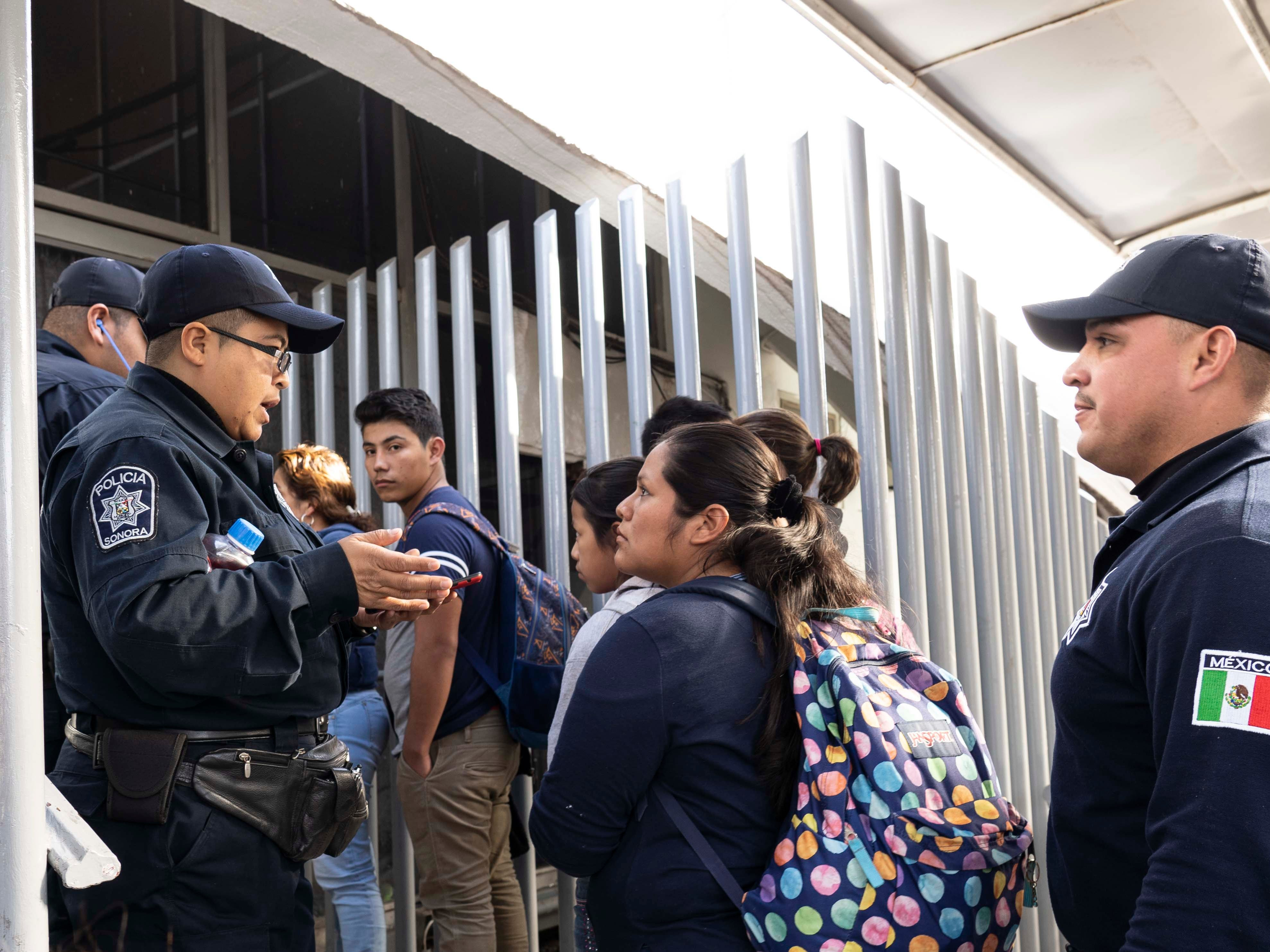 Migrants arrive at Mexican Immigration in Sonora, Mexico after being deported from the United States on Jan. 18, 2019.