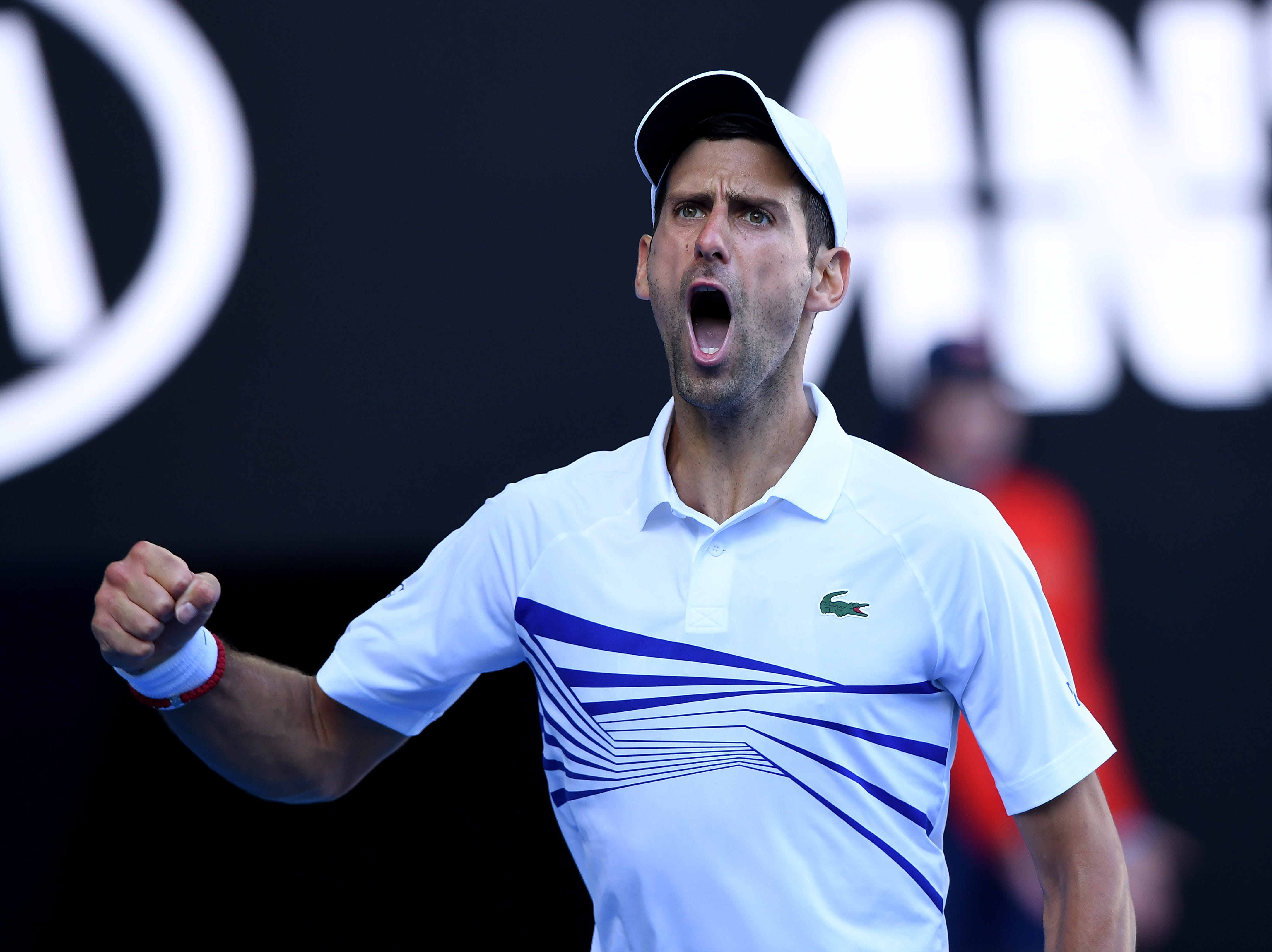 Novak Djokovic reacts while in action against Denis Shapovalov during their third-round match.