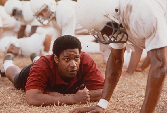 """Denzel Washington, as coach Herman Boone, in a scene from the drama """"Remember the Titans."""""""