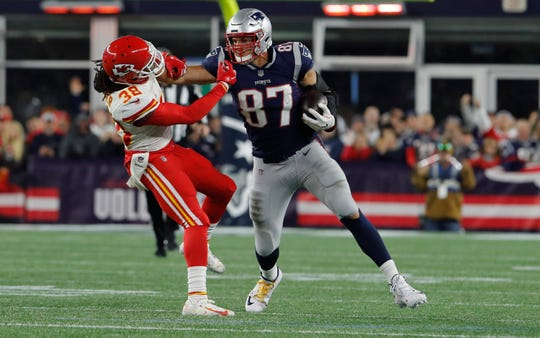 New England Patriots tight end Rob Gronkowski (87) makes a catch and stiff arms Kansas City Chiefs free safety Ron Parker (38) in the second half at Gillette Stadium.